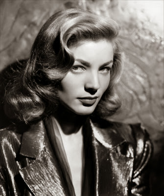 It's a real squeaker right now with Lauren Bacall leading by one point against Grace Kelly; 28 to 27.  Still anyone's game on this one.